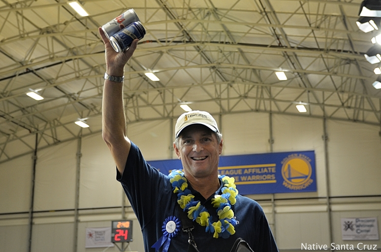 Jon Sisk of Lighthouse Bank hawking beer at a Santa Cruz Warriors game.