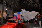 A giant bird of peace puppet and a really cool old little car.